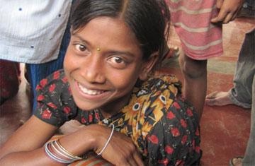 aklima-glimlach