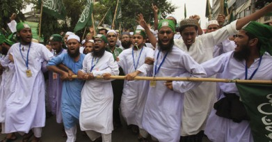 Activists of Islamist group Bangladesh Jamiyat-e-Hizbullah chant slogans during a protest rally near the national mosque in Dhaka